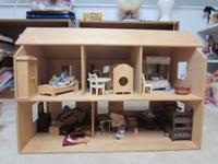 This is a stunning, simple wooden doll house for
