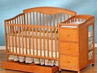 Gently used light brown Simplicity Crib combo. This