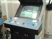 Here for sale or for trade Simpsons Arcade Machine it