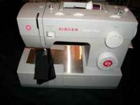 Up for sale is a Singer Heavy Duty 4423 Sewing