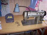 singer 20u33 a $750 machine in like new condition easy