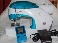 SINGER 'IZEK' SEWING MACHINE--SLIGHTLY USED--$250.00