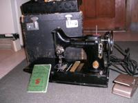 Singer Portble Sewing machine. It is the model 221-1.
