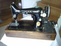 Old Singer stitching machine. If it runs otherwise, has