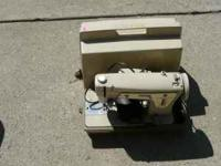 Singer sewing machine with case. Call  Location: