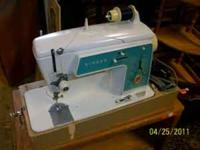 Singer sewing machine. AMAZING FINDS Home Furnishings &