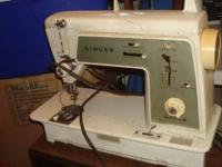 Old portable Singer Electric Sewing Machine It runs, I