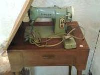 Singer sewing machine for sale already on table stand