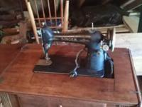 This is a old Singer sewing machine, Good shape, Price