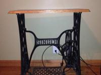 Antique singer sewing machine table. Repurposed