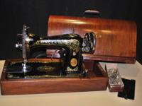 This is a very nice old Singer Sewing Machine. It was