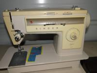 Singer sewing machine---stylist 513 with foot pedal.