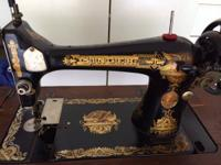 This is genuine Singer (non electric) Sewing Machine in