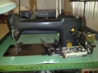 I am selling a Singer 241-13 sewing machine, mounted in