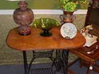Beautiful table made from antique sewing machine.
