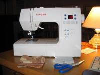 I'm selling my Singer touch and sew machine! It's been