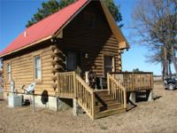 Right here is a stunning cabin with acreage situated