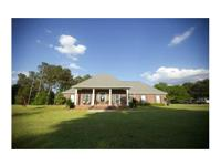ABSOLUTELY GORGEOUS Custom Built home on approximately