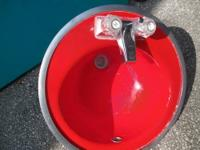 "Lipstick Red 18"" Round Sink with Silver colored faucets"