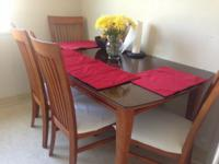 These solid wood 6chairs  Elegant dining table Cost me