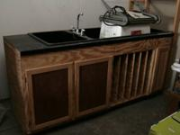 This is a custom built darkroom sink with a long