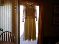 Cream colored formal dress with lacey long sleeved