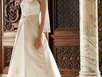 This is a lovely bridal gown, size 18, that never ever
