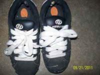 Size 4 heelys in good shape. Call  Location: Kaukauna