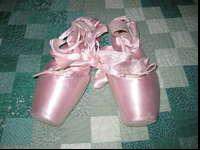 Pink toe shoes in like new condition due to only worn