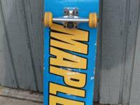 Just an old skateboard needing a rider.  There's