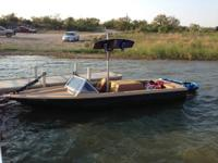 Here is an 1983 Ski Supreme boat with a wakeboard pole