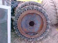 Set of 4 Skid Loader HARD tires. These came off of a