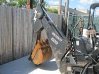 Skid Steer Attachment - Bradco Backhoe Attachment