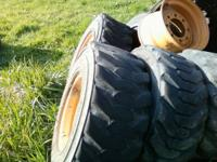 i have 4 wheels and 5 tires from a skid steer loader