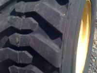 For sale I have a skid steer tire and rim,the rim is