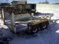 Low profile, double axle skid loader trailer, all steel