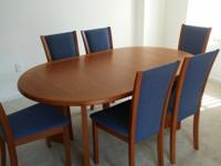 Imported dining room set includes main table, 2 leaves,