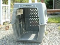 This Sky Kennel is in good condition. It is made for