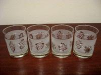 Set of 6 slanted drinking glasses trimmed in gold. Very