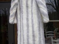 Very nice condition ladies faux fur coat measures size
