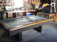 solid slate pool table with balls and sticks, table