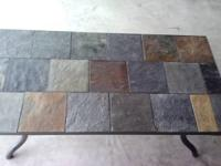 This is a metal and slate tile coffee table in terrific