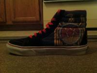 A pair of limited edition Slayer sk8 hi vans. Great