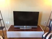 Sleek, modern, mid century style tv stand. solid wood.