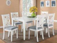 The Brooklyn white dining table set has smooth,