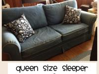 Denim Queen size sleeper sofa. Denim is faded from sun.