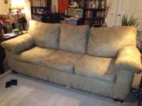 Selling a tan microfiber sleeper-sofa couch. The couch