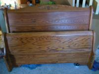 Beautiful gently used Queen sized solid oak Sleigh bed