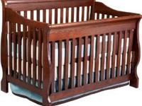 4in1 Sleigh style cherry crib in great condition! $200