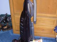 slightly used Kenmore Progressive 12 amp upright vacuum